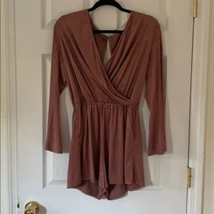 Women's mauve romper with pockets.
